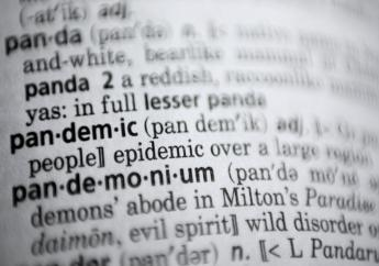 """In this Saturday, November 21, 2020, photo the word pandemic is displayed in a dictionary in Washington. Merriam-Webster on Monday announced """"pandemic"""" as its 2020 word of the year. (AP Photo/Jenny Kane)"""