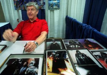 "FILE - In this file photo dated Friday, May 7, 1999, Dave Prowse, the original Darth Vader from the ""Star Wars Trilogy,"" poses during the New York Comic and Fantasy Creators Convention. The British actor, Prowse who played Darth Vader in the original Star Wars trilogy, has died aged 85 on Saturday, according to an announcement by his agent Sunday November 29, 2020. (AP Photo/Lynsey Addario, FILE)"