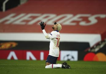PSG's Neymar celebrates after scoring his side's third goal during a Group H Champions League match between Manchester United and Paris Saint Germain at the Old Trafford stadium in Manchester, England, Wednesday, December 2, 2020. (AP Photo/Dave Thompson)