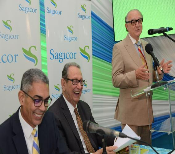 It was a special and happy occasion for R. Danny Williams (seated at right), outgoing Chairman of the Sagicor Group Jamaica, as he was conferred the honour of being named Director Emeritus of the Group by Stephen McNamara (standing), Chairman of Sagicor Financial Corporation. Pictured left is Richard Byles, the incoming chairman.