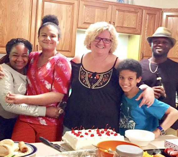 Ann-Marie English surrounded by her family.