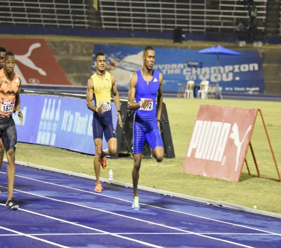 British sprinter Zharnel Hughes powers home to win the men's 100 metres from Yohan Blake (far left) at the 42nd staging of the Gibson McCook Relays at the National Stadium on Saturday night. (PHOTO: Marlon Reid).