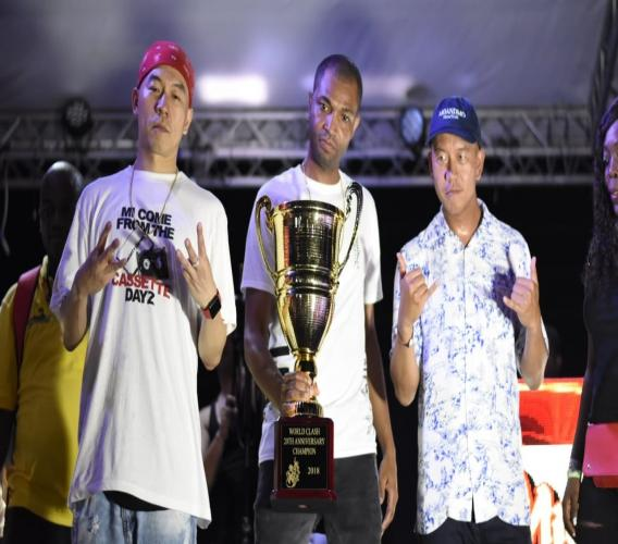 Mighty Crown pose for pictures with the winning trophy at the Sumfest edition of World Clash held at Pier One in Montego Bay, St James on Thursday. (PHOTOS: Marlon Reid)