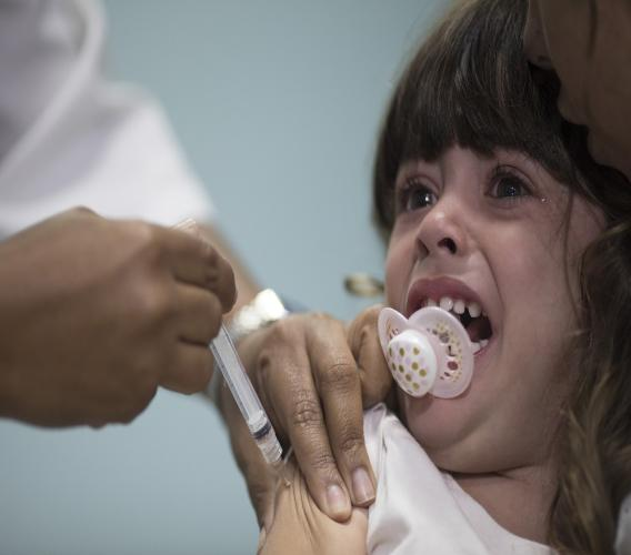 A child receives a measles vaccination in Rio de Janeiro, Brazil. (AP Photo)