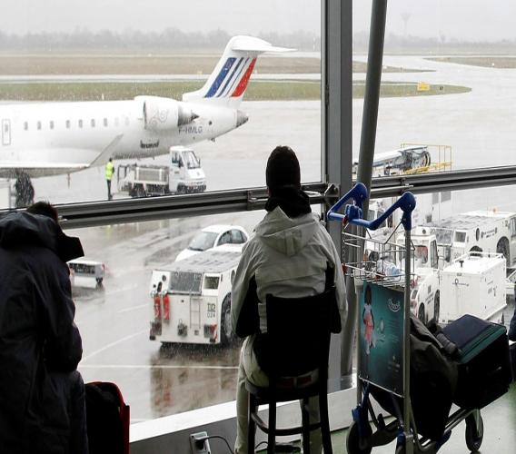 FILE - In this Dec.17, 2011 file photo, a passenger waits for his flight during a strike at Lyon-Saint Exupery airport, central France. (AP Photo/Laurent Cipriani, File)