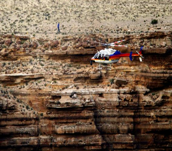 Daredevil Nik Wallenda crosses a tightrope 1,500 feet above the Little Colorado River Gorge, Ariz., on the Navajo Nation outside the boundaries of Grand Canyon National Park.  (AP Photo/Rick Bowmer, File)