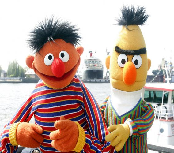 """Ernie and Bert of """"Sesame Street"""" pose in front of the Queen Mary II in the harbor of Hamburg, Germany.  (AP Photo/Fabian Bimmer, File)"""
