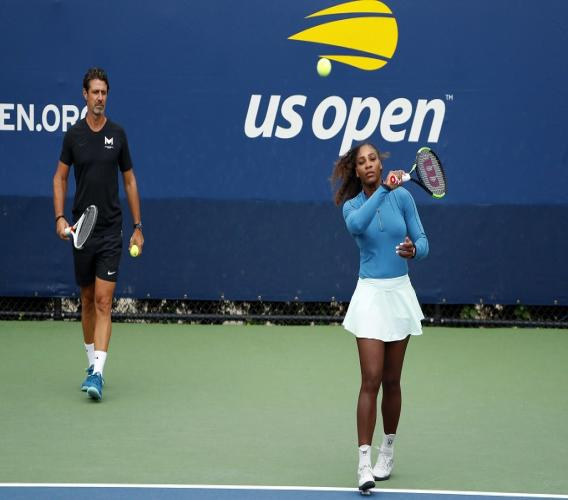 In this Aug. 31, 2018, file photo, Serena Williams walks on a practice court with her coach, Patrick Mouratoglou, during the third round of the U.S. Open tennis tournament, in New York.