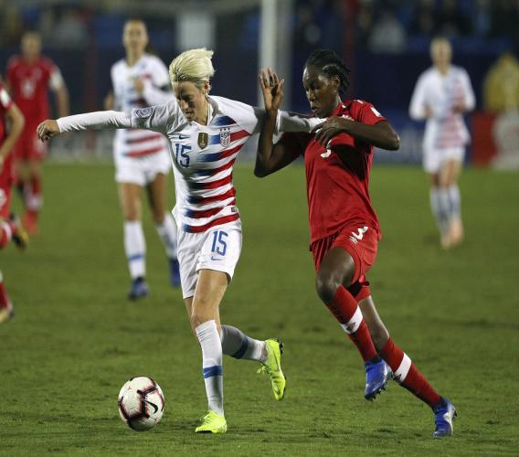 USA forward Megan Rapinoe (15) and Canada Kadeisha Buchanan battle for the ball in the first half of the finals of the concacaf Women's football Championship on Wednesday, Oct. 17, 2018, in Frisco, Texas.