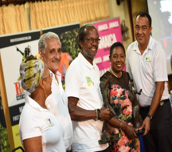 """Reggae Marathon race director Alfred """"Franno"""" Francis  (centre) with director of sponsorship and marketing, Diane Ellis; chairman Richard Lake; Sports Minister Olivia Grange and Health Minister Dr Christopher Tufton at last year's launch of the event."""