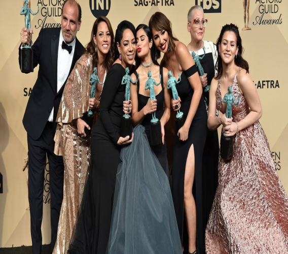 "In this Sunday, Jan. 29, 2017 file photo, Nick Sandow, from left, Elizabeth Rodriguez, Selenis Leyva, Diane Guerrero, Jackie Cruz, Lori Petty and Yael Stone pose in the press room with the award for outstanding performance by an ensemble in a comedy series for ""Orange Is The New Black"" at the 23rd annual Screen Actors Guild Awards at the Shrine Auditorium & Expo Hall in Los Angeles. ""Orange Is the New Black"" is fading to black after its upcoming seventh season."