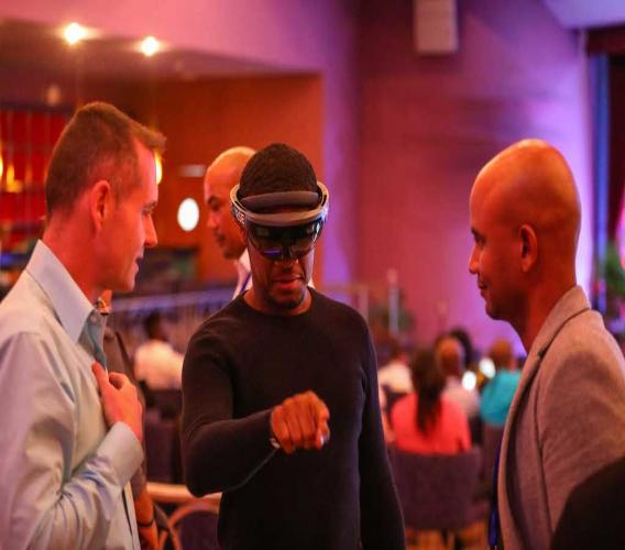 Kirk-Anthony Hamilton (right), co-founder and curator of Tech Beach Retreat, in discussion with participants at last year's Tech Beach Retreat.