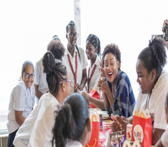 Nailah Blackman delights some of the young ladies of The Heroes Foundation