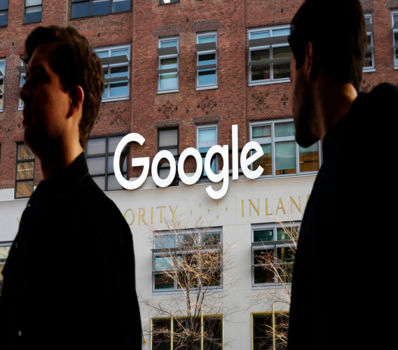 FILE - In this Dec. 4, 2017 file photo, people walk by Google offices in New York. The Wall Street Journal reports that Google is planning a major expansion in New York City. The newspaper reported Wednesday, Nov. 7, 2018, that the company plans to add space for more than 12,000 additional New York workers. The Journal cited anonymous people familiar with the plans. (AP Photo/Mark Lennihan, File)
