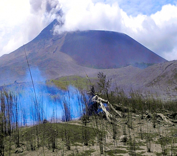 In this July 3, 2011, file photo, shows Mount Soputan seen from Tombatu village in North Sulawesi, Indonesia. Mount Soputan, located on the northern part of Sulawesi island, erupted twice Sunday morning, Dec. 16, 2018, according to the national disaster agency's spokesman, Sutopo Purwo Nugroho. (AP Photo/Grace Wakary, File)