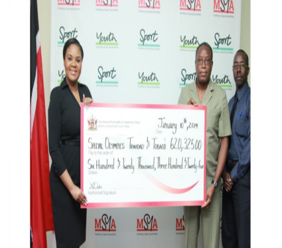 Shamfa Cudjoe, Minister of Sport and Youth Affairs, presents a cheque to Ferdinand Bibby,  National Director - Special Olympics TT, as Patrice Charles, Director - Physical Education and Sport looks on.