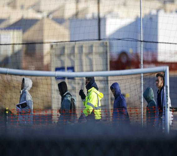 In this Dec. 13, 2018, file photo, teen migrants walk in line inside the Tornillo detention camp in Tornillo, Texas. (AP Photo/Andres Leighton, File)