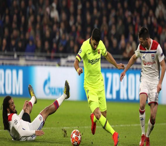 Lyon defender Jason Denayer, left, and Lyon defender Leo Dubois, right, challenge Barcelona forward Luis Suarez, center, during the Champions League round of 16 first leg football match in Decines, near Lyon, central France, Tuesday, Feb. 19, 2019.