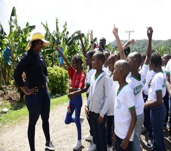 """Students of Pembroke Hall Primary are quick to respond to questions about bananas posed by Tara Goulbourne (left), Commercial Manager at JP Tropical Foods, as they prepare to step on to farm during the """"Plant with JP"""" farm tour."""