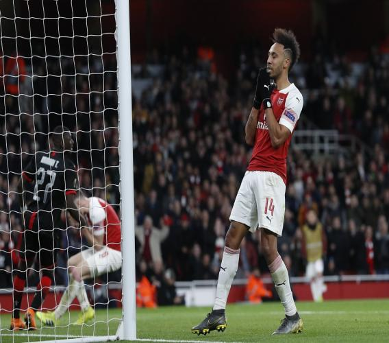 Arsenal's Pierre-Emerick Aubameyang, right, reacts after a missed scoring opportunity during the Europa League round of 16, 2nd leg, football match against Rennes at the Emirates stadium in London, Thursday, March 14, 2019.