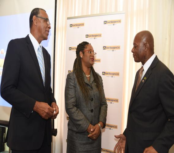 Nina Peters (centre), Business Relationship and Sales Manager, JN Bank, converses with Byron Farquharson (left), Secretary General, Jamaica Teachers' Association (JTA) and Devon Meeks, North Eastern Regional Secretary, JTA, during at a recent investment seminar organised for teachers in western Jamaica.