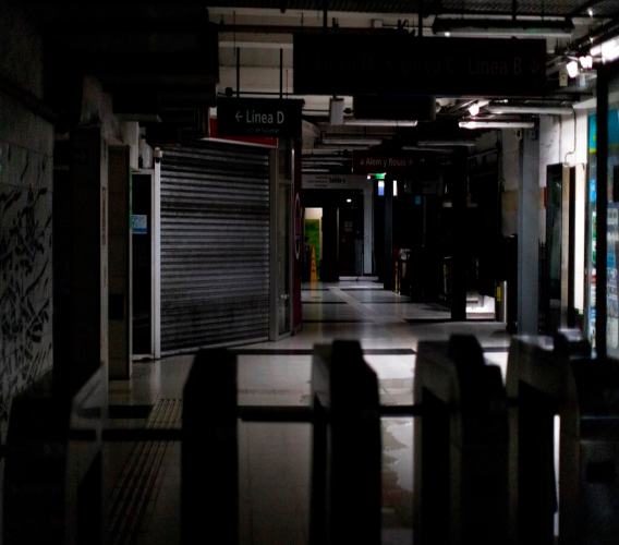 Hallways of Buenos Aires's subway are lit only by emergency lights during a blackout in Buenos Aires, Argentina, Sunday, June 16, 2019. Argentina and Uruguay were working frantically to return power on Sunday, after a massive power failure left large swaths of the South American countries in the dark. (AP Photo/Tomas F. Cuesta)