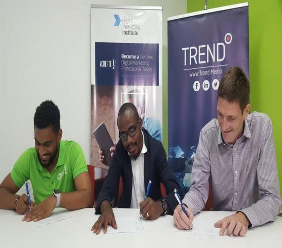 (From left) iCreate General Manager Carl Carram and CEO Tyrone Wilson with Declan Tully, Group Head of Revenue for Trend Media, at the signing ceremony held at the Trend Media headquarters in Kingston on Friday. (PHOTOS: Marlon Reid)