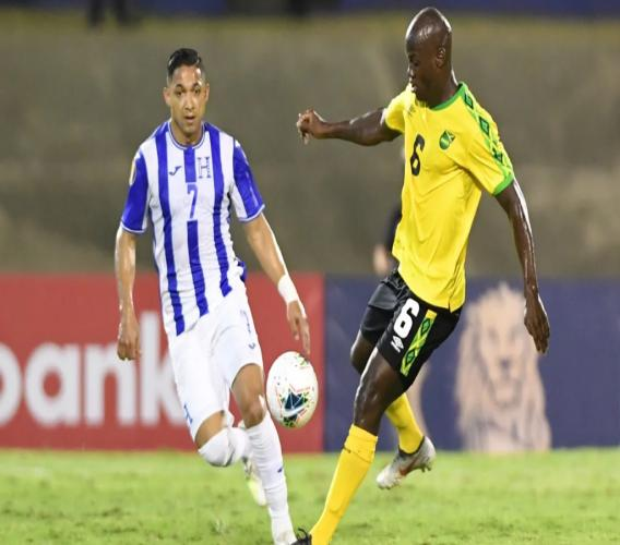 Jamaica's Dever Orgill (right)  takes on Emilio Izaguirre of Honduras in the country's historic hosting of a Concacaf Gold Cup match on June 17, 2019 at the National Stadium in Kingston, Jamaica. Orgill scored two goals to lead the Reggae Boyz to a 3-2 victory. (PHOTO: Concacaf.com).