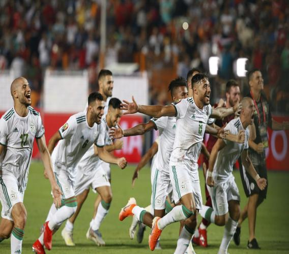Algerian players celebrate after the African Cup of Nations final football match against Senegal in Cairo International stadium in Cairo, Egypt, Friday, July 19, 2019. (AP Photo/Ariel Schalit).