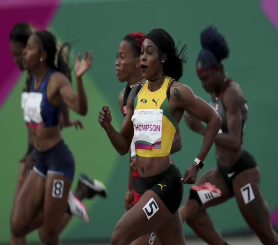 Elaine Thompson of Jamaica runs to win the 100m final during the athletics at the Pan American Games in Lima, Peru, Wednesday, Aug. 7, 2019. (AP Photo/Fernando Llano).