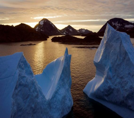 An aerial view of large Icebergs floating as the sun rises near Kulusuk, Greenland, early Friday, Aug. 16, 2019. (AP Photo/Felipe Dana)