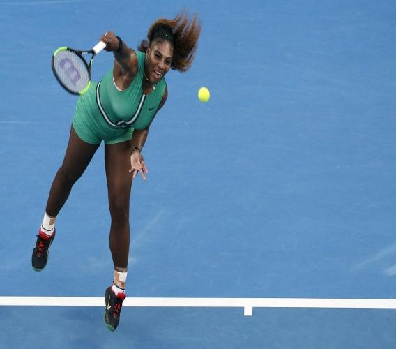 In this Jan. 21, 2019, file photo, Serena Williams serves to Romania's Simona Halep during their fourth round match at the Australian Open tennis championships in Melbourne, Australia.