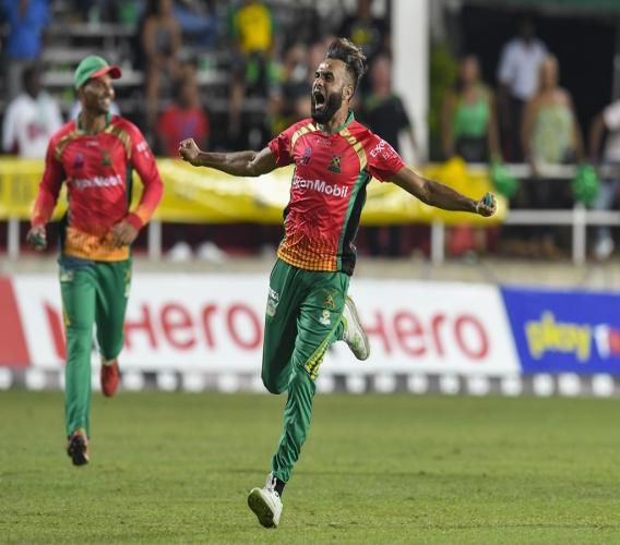 Imran Tahir (right) of Guyana Amazon Warriors celebrates the dismissal of Chris Gayle of Jamaica Tallawahs during match 15 of the Hero Caribbean Premier League at Sabina Park on September 18, 2019 in Kingston, Jamaica. (Photo by Randy Brooks - CPL T20/Getty Images).