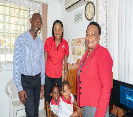GK Insurance General Manager Chaluk Richards and Montego Bay branch head Nadia Williams (second left) pause for a photo op with Bright Horizon Basic School Principal Valerie Wade (far right) and students Arianna Montaque (second right) and Mia Codner.