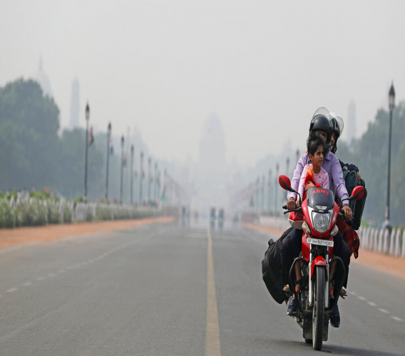 India's Presidential Palace, in the backdrop, is covered with smog as a family rides a motorbike on Rajpath, the ceremonial boulevard, in New Delhi, India, November 19, 2019. (AP Photo/Altaf Qadri)