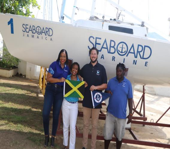 Left to right: Eleanor Williams - Branch Manager Seaboard Freight Montego Bay, Coreen Williams - Director of sales & Marketing, Seaboard Freight, Spencer May, Vice Commodore, Montego Bay Yacht Club and Dawson Morission, Dock Master, Montego Bay Yacht Club pose infront of one of two boats brought in from Cayman Islands for the event, with the support from Seaboard.