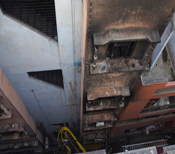 The walls of a building stand blackened after it caught fire in New Delhi, India, Sunday, December 8, 2019. (AP Photo/Dinesh Joshi)
