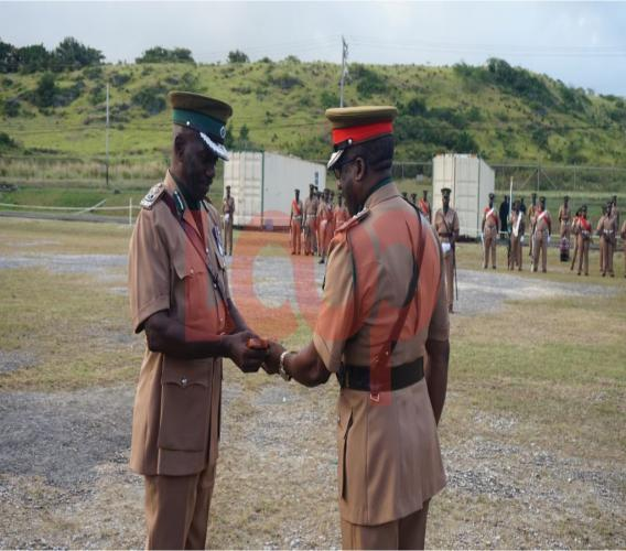Return of the key of Command for Retired Assistant Superintendent of Prisons Cedrick Moore over to Superintendent of Prisons Lt. Col. John Nurse