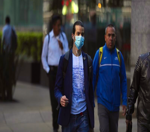 A man wears a mask over his mouth as a precaution against the spread of the new coronavirus COVID-19 in Mexico City, Friday, Feb. 28, 2020. Mexico's assistant health secretary announced Friday that the country now has confirmed cases of the new coronavirus. (AP Photo/Fernando)