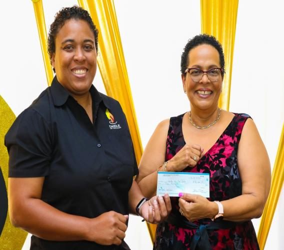 Wendy Freckleton (left), Chairman, Candle in the Dark, accepts a cheque valued at $50,000 from Dale Greaves-Smith, Branch Manager, Sagicor Life Jamaica, Mandeville, during an awards ceremony by the branch on March 12 at the Moreland Estate Clubhouse in Manchester.