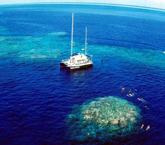 In this December, 1999, file photo, tourists snorkel around Upolu Cay on the Great Barrier Reef near Cairns off the Australian north east coast. (AP Photo/Brian Cassey, File)