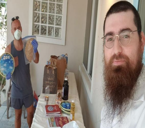 Rabbi Berel Pewzner providing Passover supplies to members of Cayman's Jewish Community