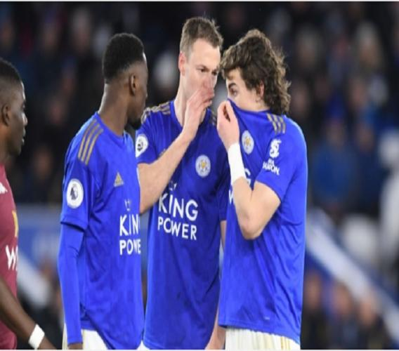 Leicester City players talk during the last Premier League game before play was suspended because of the spread of coronavirus.