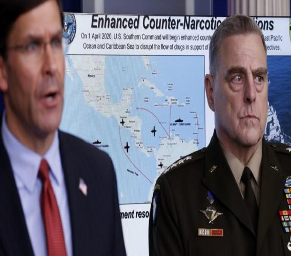 Defense Secretary Mark Esper speaks about the coronavirus and illegal drugs in the James Brady Press Briefing Room of the White House, Wednesday, April 1, 2020, in Washington, as Chairman of the Joint Chiefs Gen. Mark Milley, listens. (AP Photo/Alex Brandon)