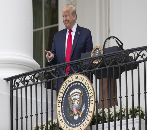 """President Donald Trump points during a """"Rolling to Remember Ceremony,"""" to honor the nation's veterans and POW/MIA, from the Blue Room Balcony of the White House, Friday, May 22, 2020, in Washington. (AP Photo/Alex Brandon)"""