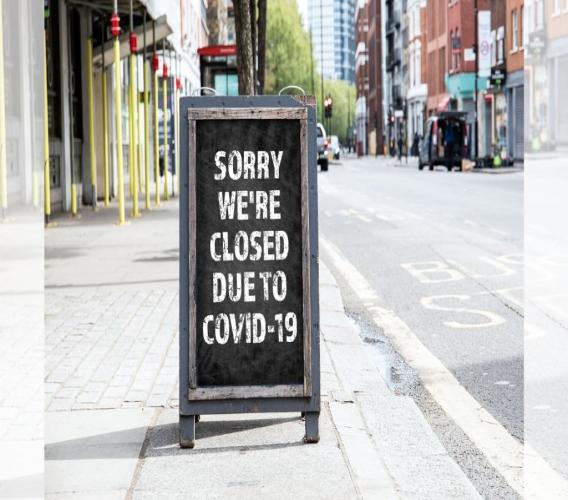 """""""Sorry we're closed due to COVID-19"""" read a sign outside a popular watering hole. (iStock Photo)"""