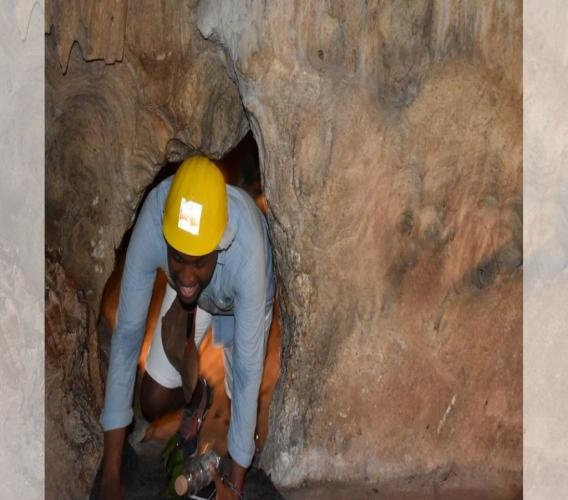 #UDCFamTour participant exits through the 'Limbo Hole' inside the Green Grotto Caves, St Ann. (Photos: Latoya Chambers)