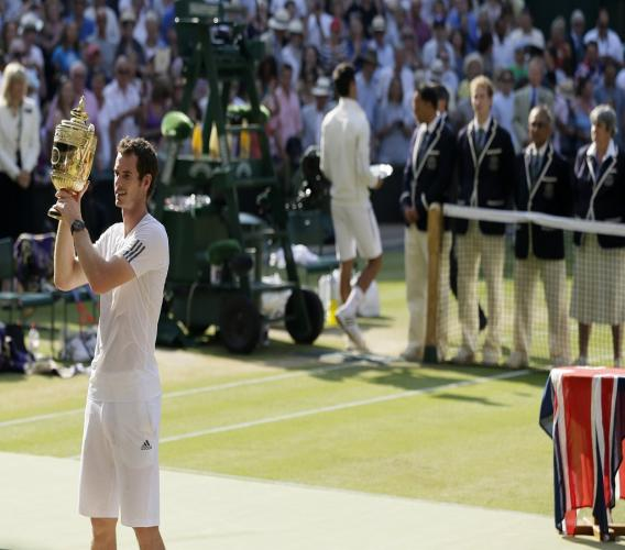 In this July 7, 2013, file photo, Andy Murray of Britain poses with the trophy after defeating Novak Djokovic of Serbia in the men's singles final match at the All England Lawn Tennis Championships in Wimbledon, London. (AP Photo/Alastair Grant, File).