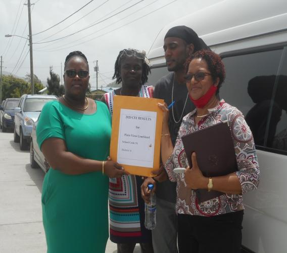 Principal Ella Thomas-John (center) with teachers just after receiving Common Entrance results