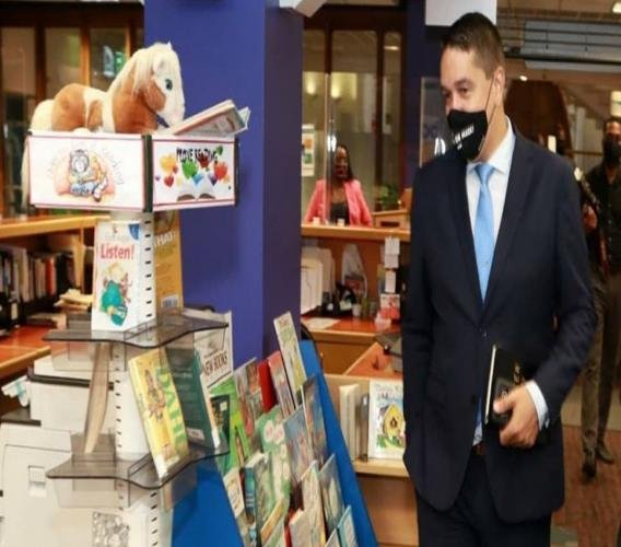 Minister in the Office of the Prime Minister with responsibility for Communications, Symon de Nobriga tours a library.